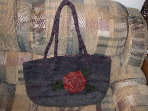 Felted_plum_bag_with_red_crocheted_flowe