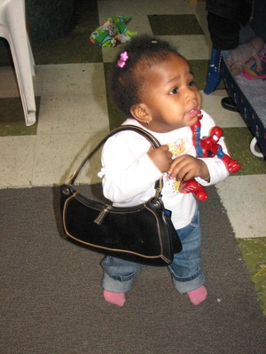 Kayla_with_purse_and_baby_spiderman
